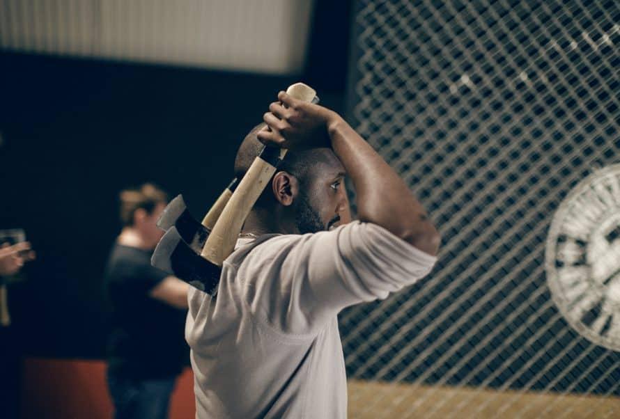 A man throwing an axe